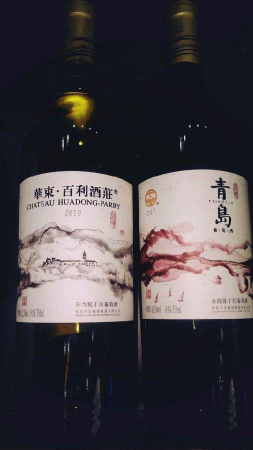 青岛荣耀赤霞珠干红葡萄酒以中国国粹水墨丹青的手法,以青岛胶州湾为